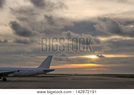 sun set with rear of an airplane in Phuket Thailand
