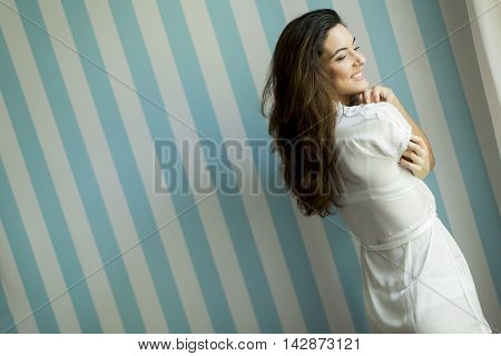 Woman By The Wall