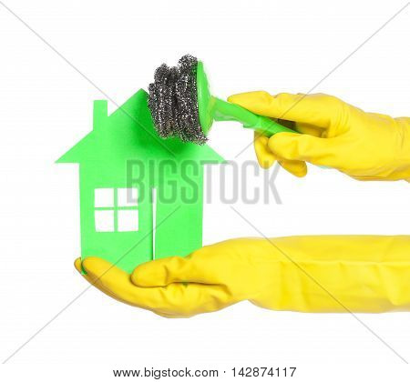 Paper house on woman hands isolated over white background
