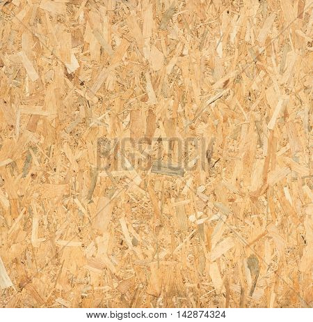close up pressed wooden panel background seamless texture of oriented strand board - OSB wood