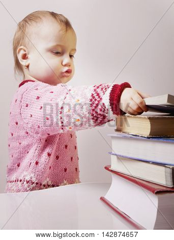 baby girl is searching a book (science development education)
