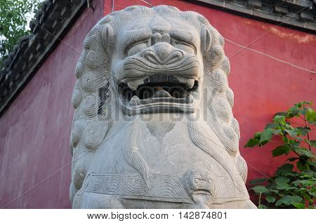 A chinese stone lion outside of the Shaolin Temple in Dengfeng city Henan Province China.