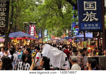 August 17 2015. Xian China. The crowded muslim food street bustling at night within the city of xian China in Shaanxi province.