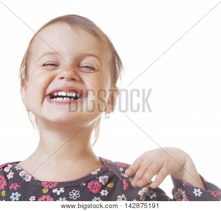 Happy childhood. A beautiful baby girl laughs (serenity security joy family)
