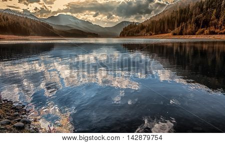 Reflection on water reservoir CIERNY VAH Slovakia