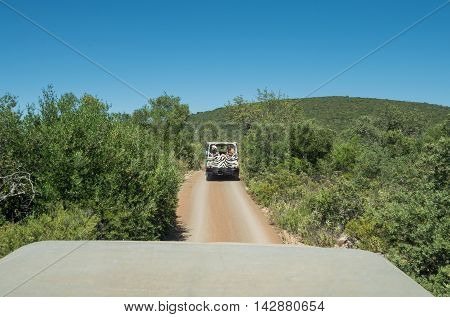 ALGARVE COAST PORTUGAL - MAY 19: Some people on the road in a jeep near the Algarve coast in Portugal 2016