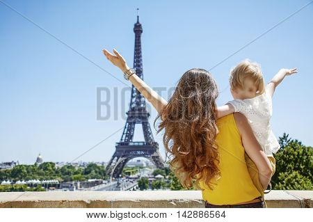 Mother And Daughter Travellers Rejoicing And Looking At Eiffel T