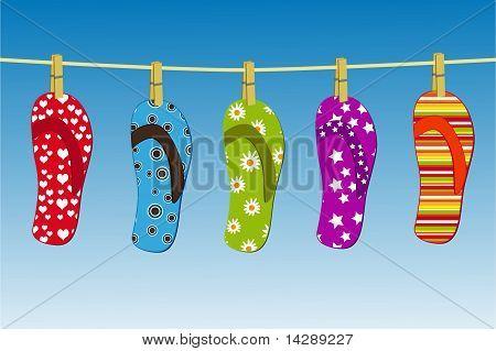 Flipflops hanging on a clothesline