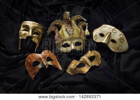 photography in the studio of different carnival masks on black background
