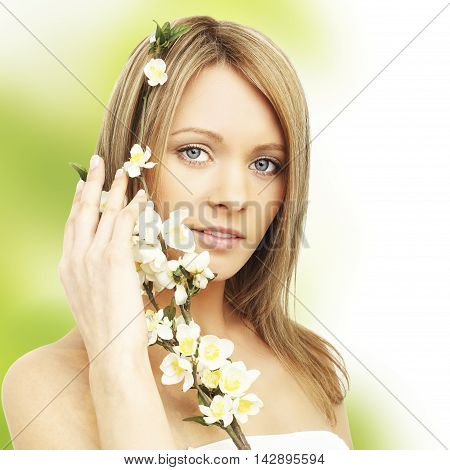 Healhy young woman with spring blossom in hands