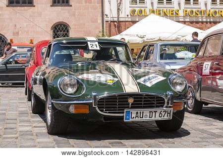 Nurnberg Bavaria / Germany - July 19th 2014: green Jaguar E Type at Sud - Rallye- Historic event in Nurnberg