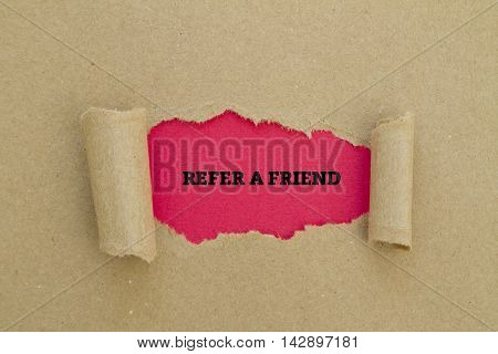 REFER A FRIEND word written under torn paper.