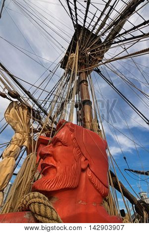 SYDNEY, AUSTRALIA - APRIL, 2016 : View of carved head of sailor painted in orange red and rigging ropes at foredeck of Tall Ship HMB Endeavour at Darling Harbour in Sydney, Australia on April 21, 2016