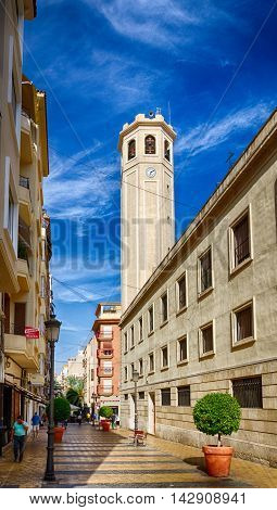 Clock tower of church Parroquia Nuestra Senora de Gracia in Alicante, Spain