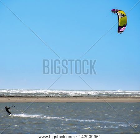 Wind surfer with parachute on the waater