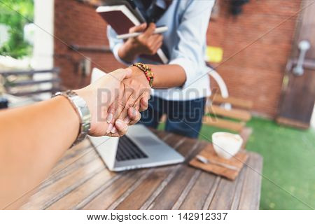 Photos of Asian women who are shaking handsFocus on hand