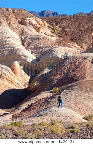 Photographer Capturing Images Of The Colorful Rock Formations In Death Valley, California