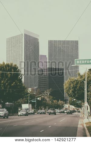 Los Angeles United States - December 27 2015: Traffic on a multi-lane road leading to the city center of Los Angeles with different skyscrapers on December 27 2015 in Los Angeles.