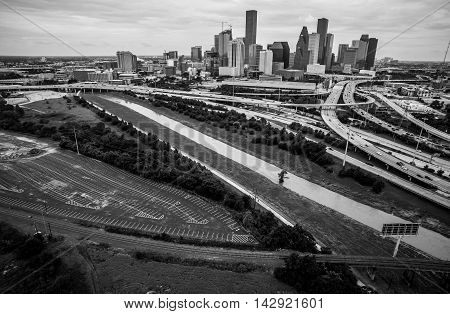 Black and White Towers Skyscrapers and Large Downtown Houston Texas Aerial Photography high above Highways and Loops and Interchanges of Urban Sprawl