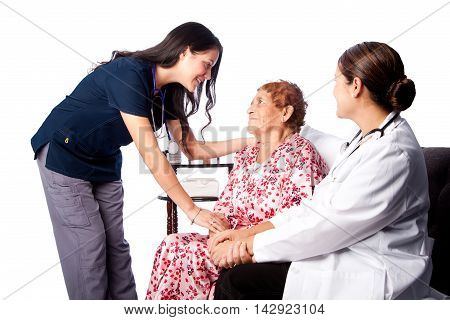 Doctor And Nurse Consulting Senior Patient