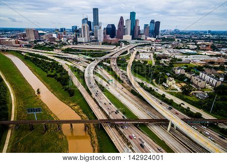 Houston Texas Aerial Urban Sprawl View Over Interstates and Highway SKyilne Cityscape with brown dirty Bayou River
