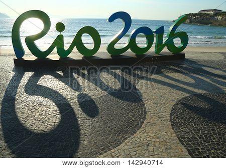 RIO DE JANEIRO, BRAZIL - AUGUST 6, 2016: Rio 2016 sign at Copacabana Beach in Rio de Janeiro
