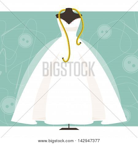 Dummy with wedding dress and centimeter on sewing background