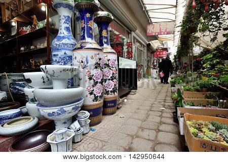 SUZHOU CHINA - MARCH 22: Traditional chinese crafts at street market on March 22 2016 in China. Suzhou is a major economic center and focal point of trade and commerce in Jiangsu Province China