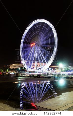 BANGKOK, THAILAND - August 16,2015 : Ferris wheel at Asiatique the riverfront in the night on August 16,2015 in Bangkok. Here is the night market in Bangkok - Thailand.