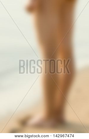 Sexy girl at the beach theme creative abstract blur background with bokeh effect