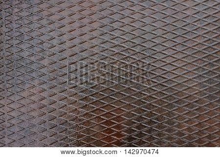 grunge metal plate background. Texture of metal plate with pattern grid of rhombuses. Metal wall. Metal background