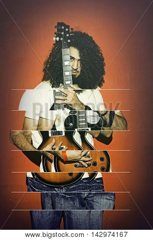 Closeup of one handsome passionate expressive cool young brunette rock musician men with long curly hair playing electro guitar standing against red background - Abstract photograph