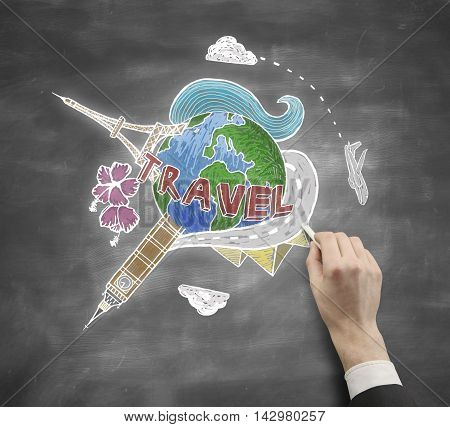 Businessman hand drawing travel sketch on chalkboard background. Traveling concept