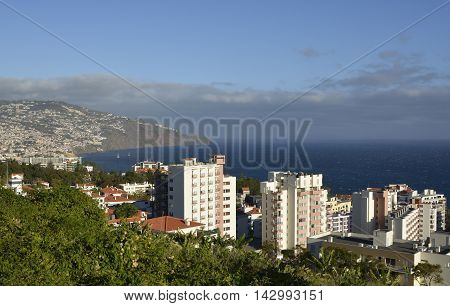 View over the city of Funchal from the suburbs. Madeira Portugal. With hotel area in foreground.