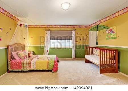 Kids Bedroom In Yellow And Green Tones With Carpet Floor