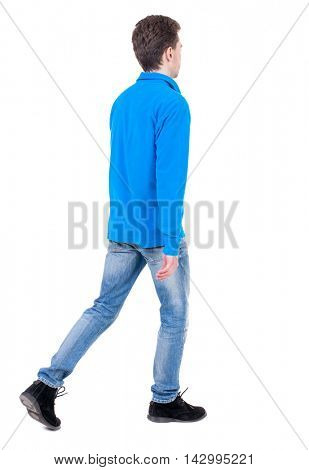 Back view of going  handsome man. walking young guy . Rear view people collection.  backside view of person.  Isolated over white background. Curly boy in blue sweater goes out of the frame.