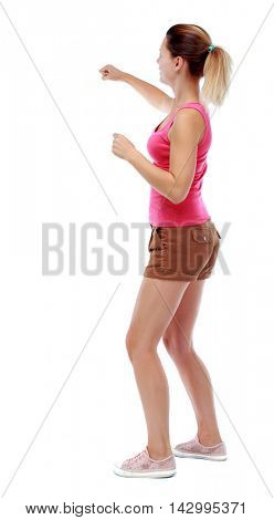 back view of woman funny fights waving his arms and legs. Rear view people collection. backside view of person.  Isolated over white background. Sport blond in brown shorts waving fists.