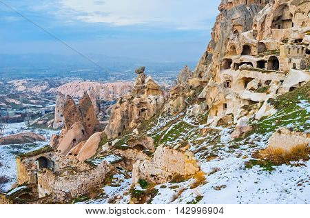 The ruins of the ancient housing in rocks located on the mountain Uchisar Cappadocia Turkey.