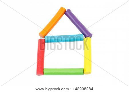 Colorful rod plasticine arranging in house shape on isolate white background