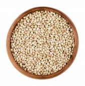 Buckwheat in a wooden bowl on white background. Small grain seeds of Fagopyrum esculentum. Edible, raw and organic food. Isolated close up macro photo. poster