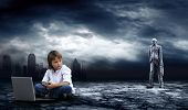 Crisis in world. Boy with laptop on dark sky with lightning poster
