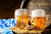 Beer. Oktoberfest.Two cold beers. Draft beer. Draft ale. Golden beer. Golden ale. Two gold beer with froth on top. Draft cold beer in glass jars in pub hotel or restaurant. Still life. poster