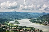 View from Ruin castle of Visegrad Hungary. Danube river. Travel destination. Sightseeing cruises. Forests clouds and flowing water. poster