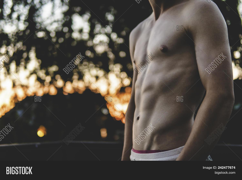Teen Flexing Sixpack  Image & Photo (Free Trial)   Bigstock