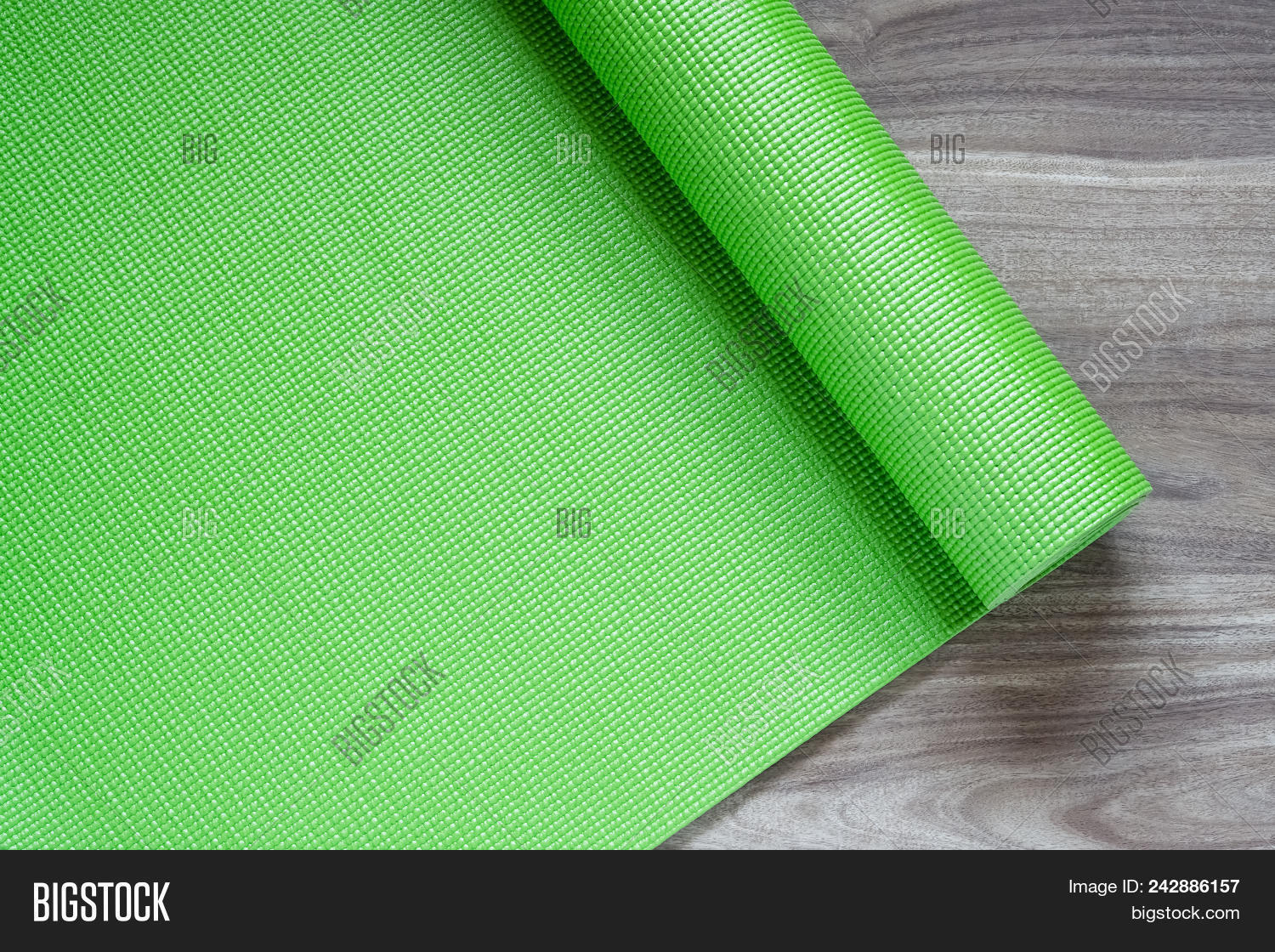 17b0196ebace0 Green yoga mat on a wooden background, Top View with copy space. Actie healthy  lifestyle background concept.