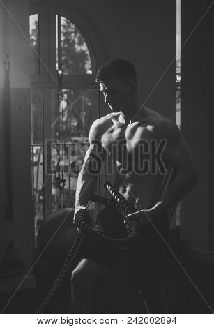 Man With Torso, Muscular Macho Does Functional Training. Man With Nude Torso In Gym Enjoy His Sporty