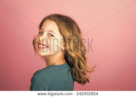 Fashion Young Kid Model Fece Close Up. Face Female Kid Wiht Happy Emotion. Stylish Girl With Pretty