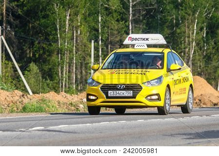 Moscow region, Russia - May, 23, 2018: taxi on a highway in Moscow region