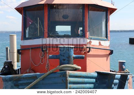 Cockpit Of A Tugboat Moored To A Dock