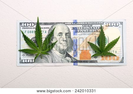 Marijuana Leaf on a 100 Dollar Bill. Isolated. Room for text.